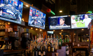 sports bar with tv's and liquor shelf