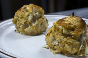 two lump crab cakes on a plate side by side